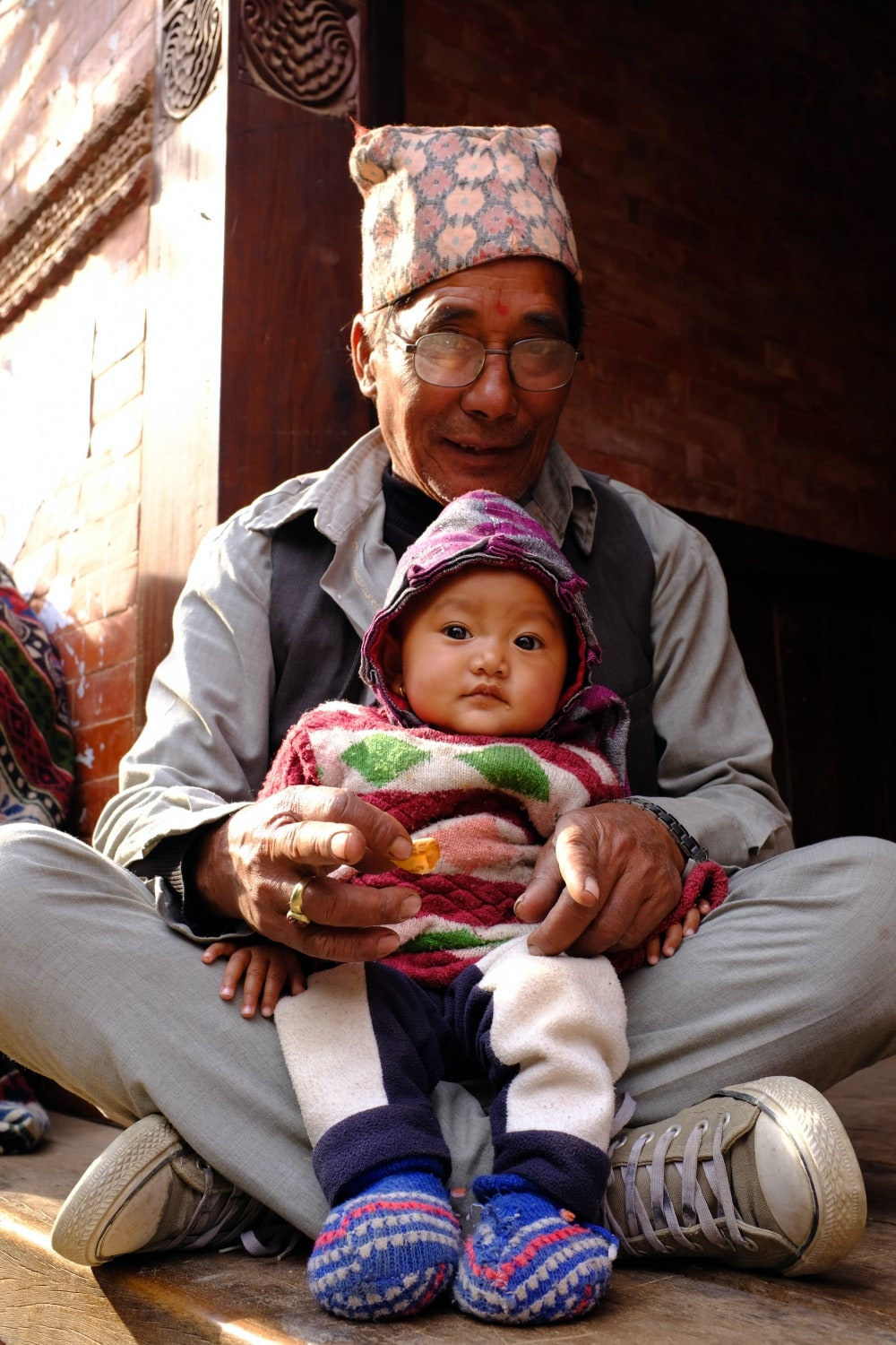 A man with his grandchild in Bhaktapur, Nepal