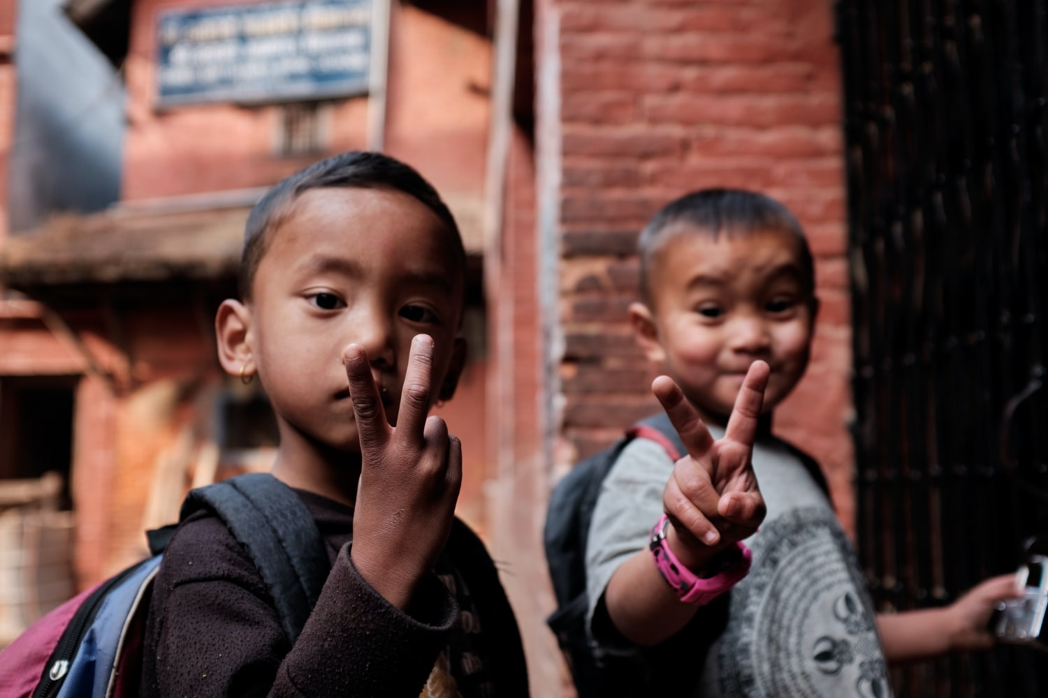 Kids outside a school in Bhaktapur pose for a picture