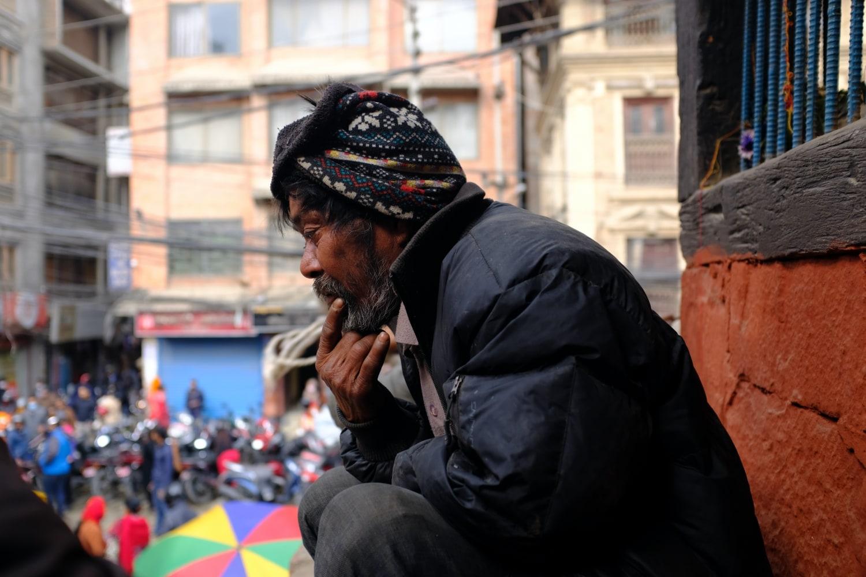 A Man Sitting by a Temple in Kathmandu