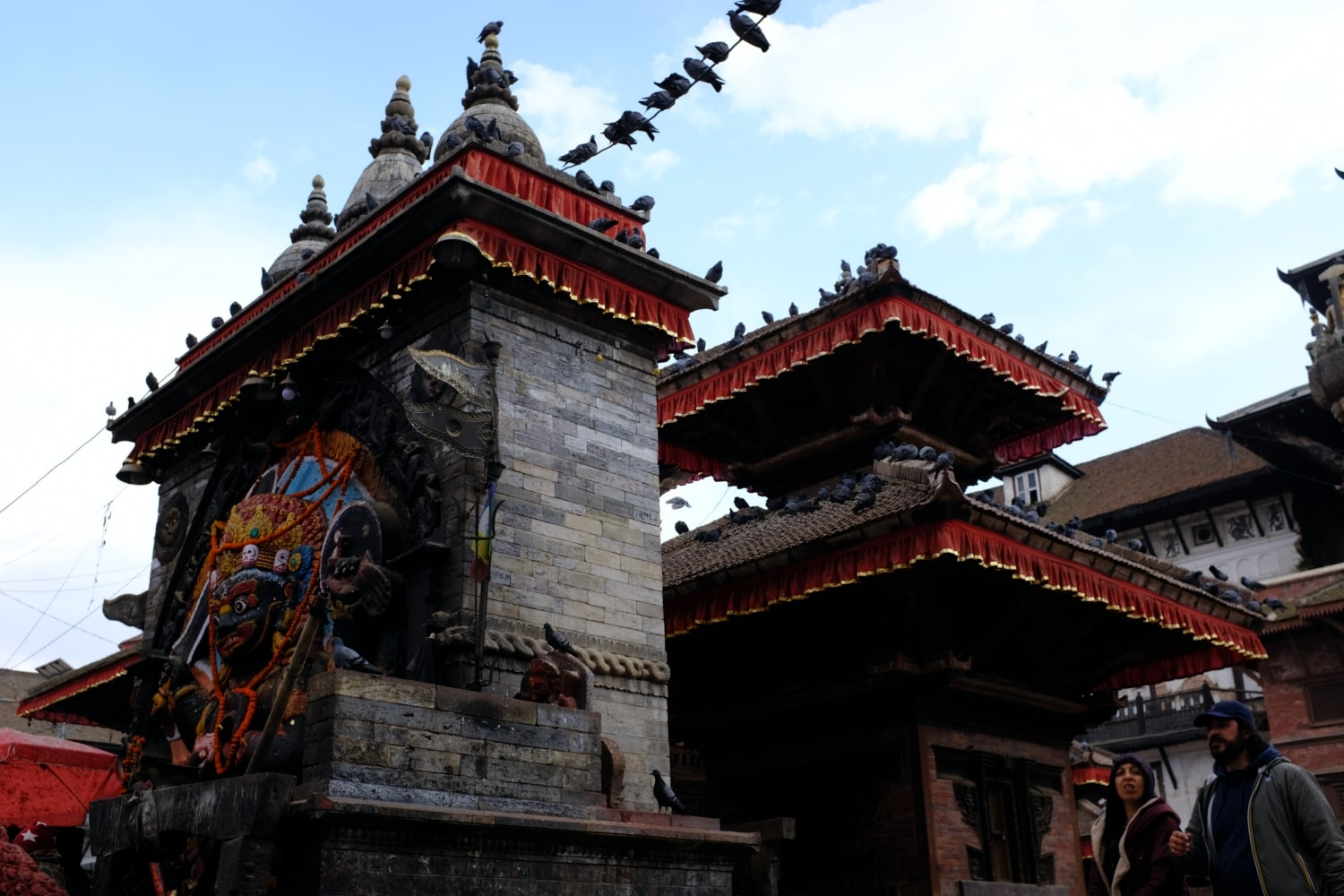 Kathmandu Durbar Square - People Passing by a Temple
