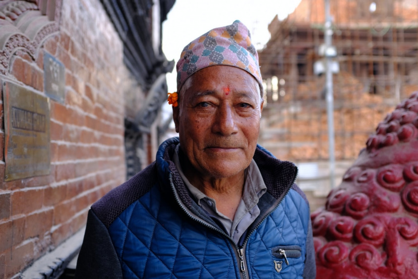 A Man Poses for a Photograph Outside Kumari House in Kathmandu