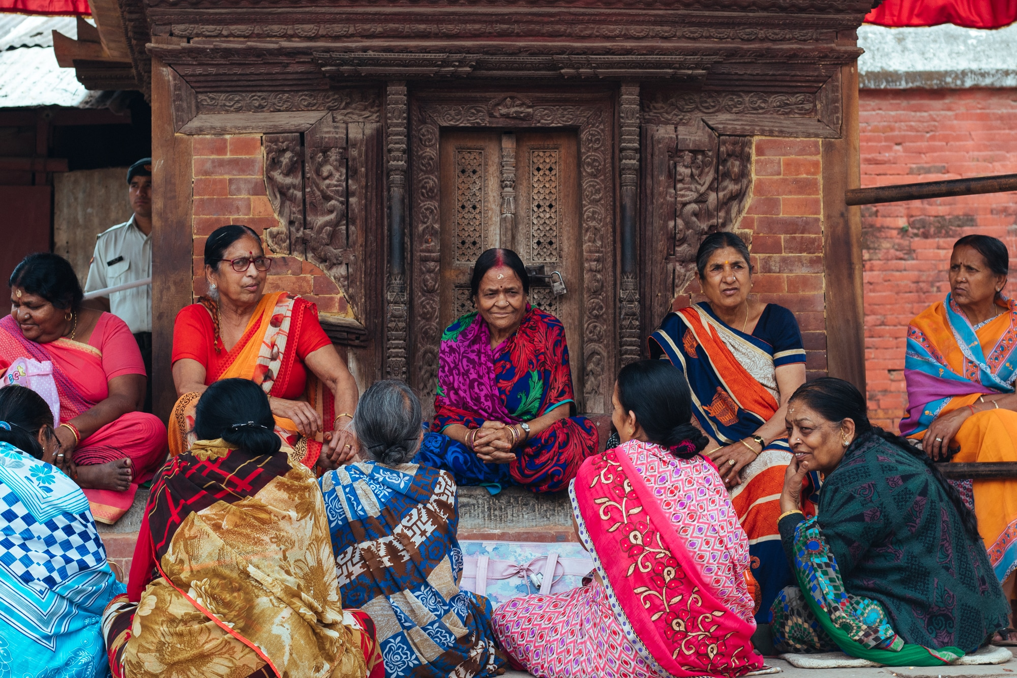 A group of women singing religious songs outside a temple in Kathmandu Durbar Square