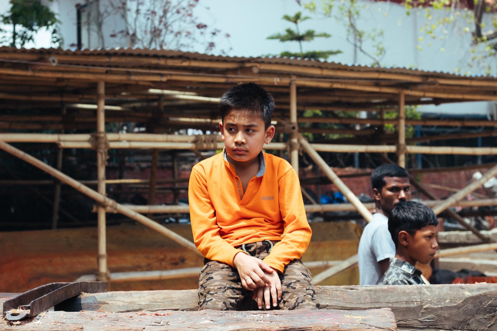 A boy sitting on a chariot