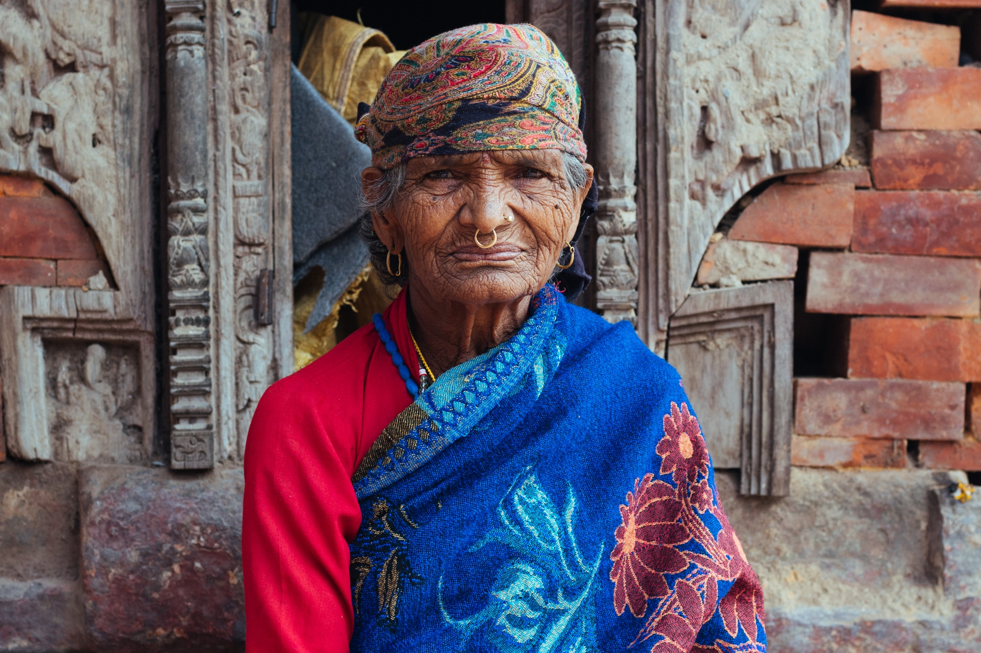An elderly woman in traditional getup