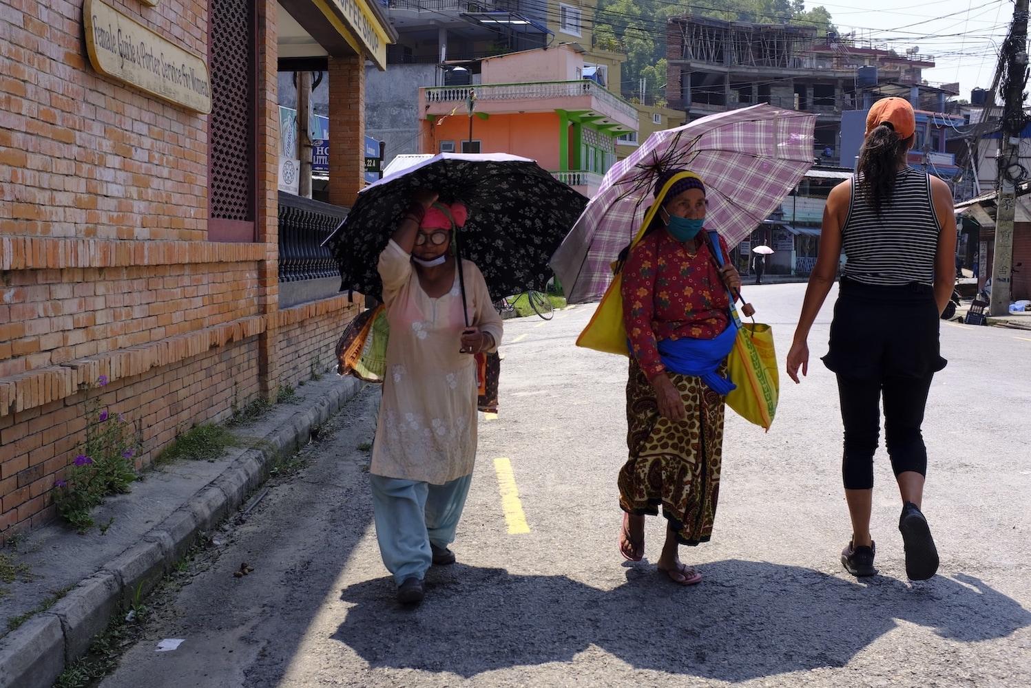Nepali women walking with umbrella in Pokhara