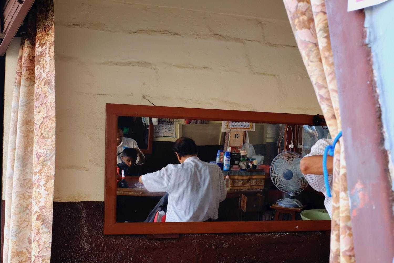 A kid getting his hair cut in Pokhara