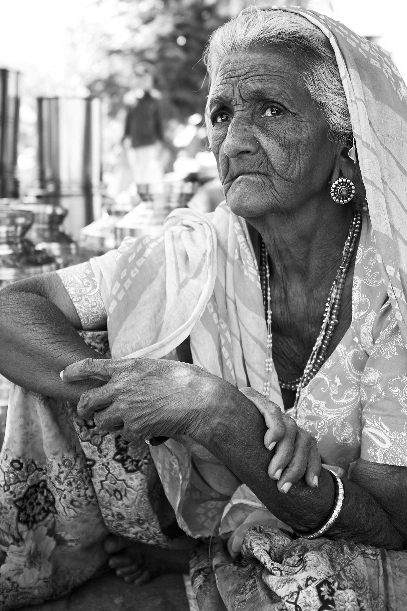 An elderly woman photographed at Ahmedabad's Sunday market