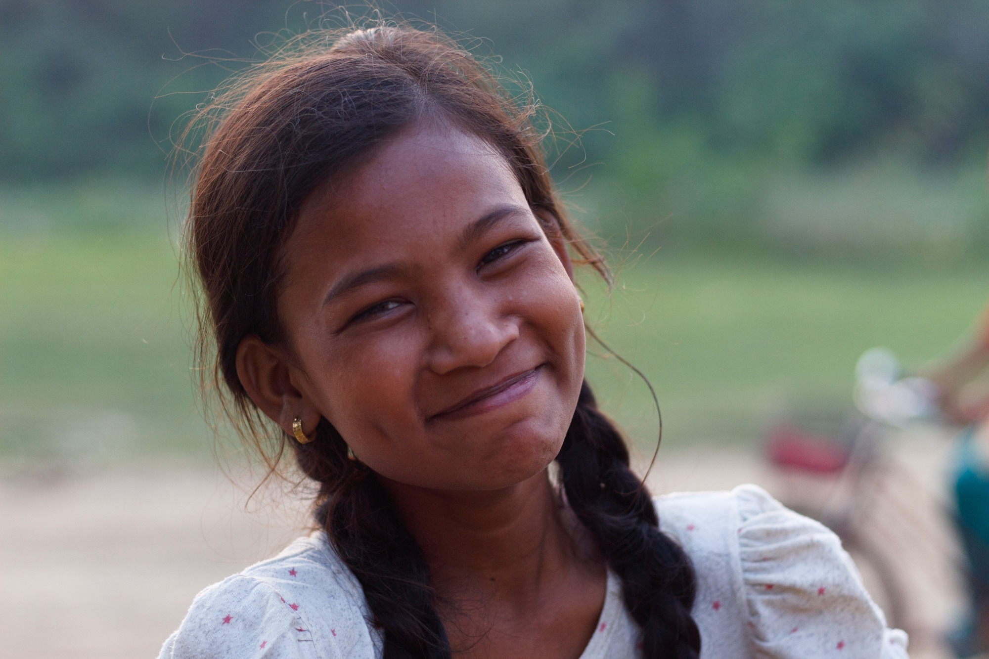 A young girl poses for a picture in Bardiya village, Nepal.