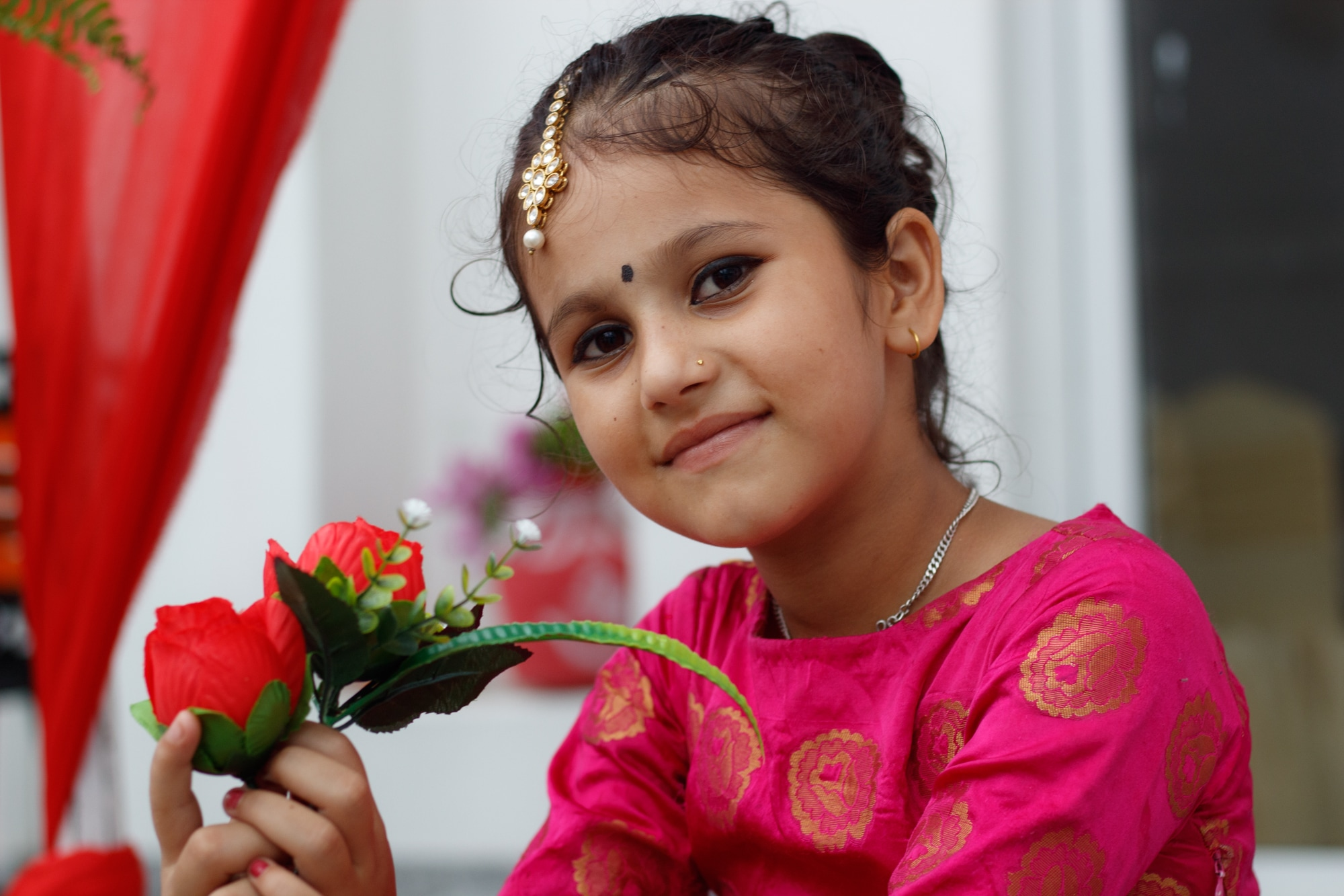 A young Nepali girl poses for a picture at a wedding.