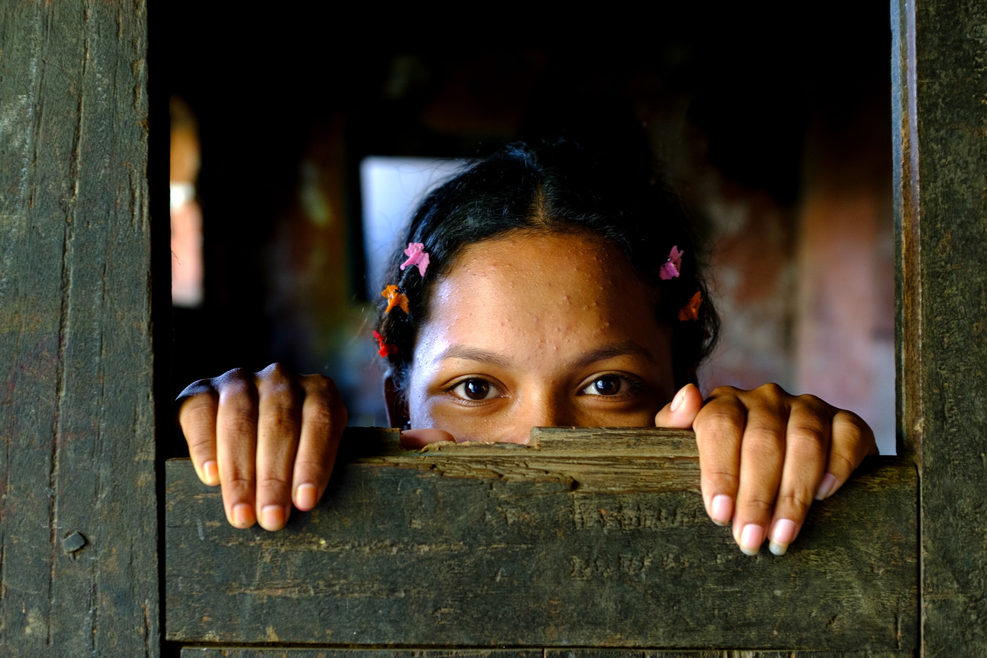 A young girl in Pokhara, Nepal poses for a picture