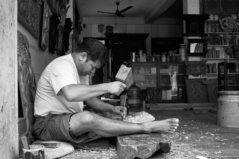 July 2021, Pokhara, Nepal: A sculpture artist working inside his shop