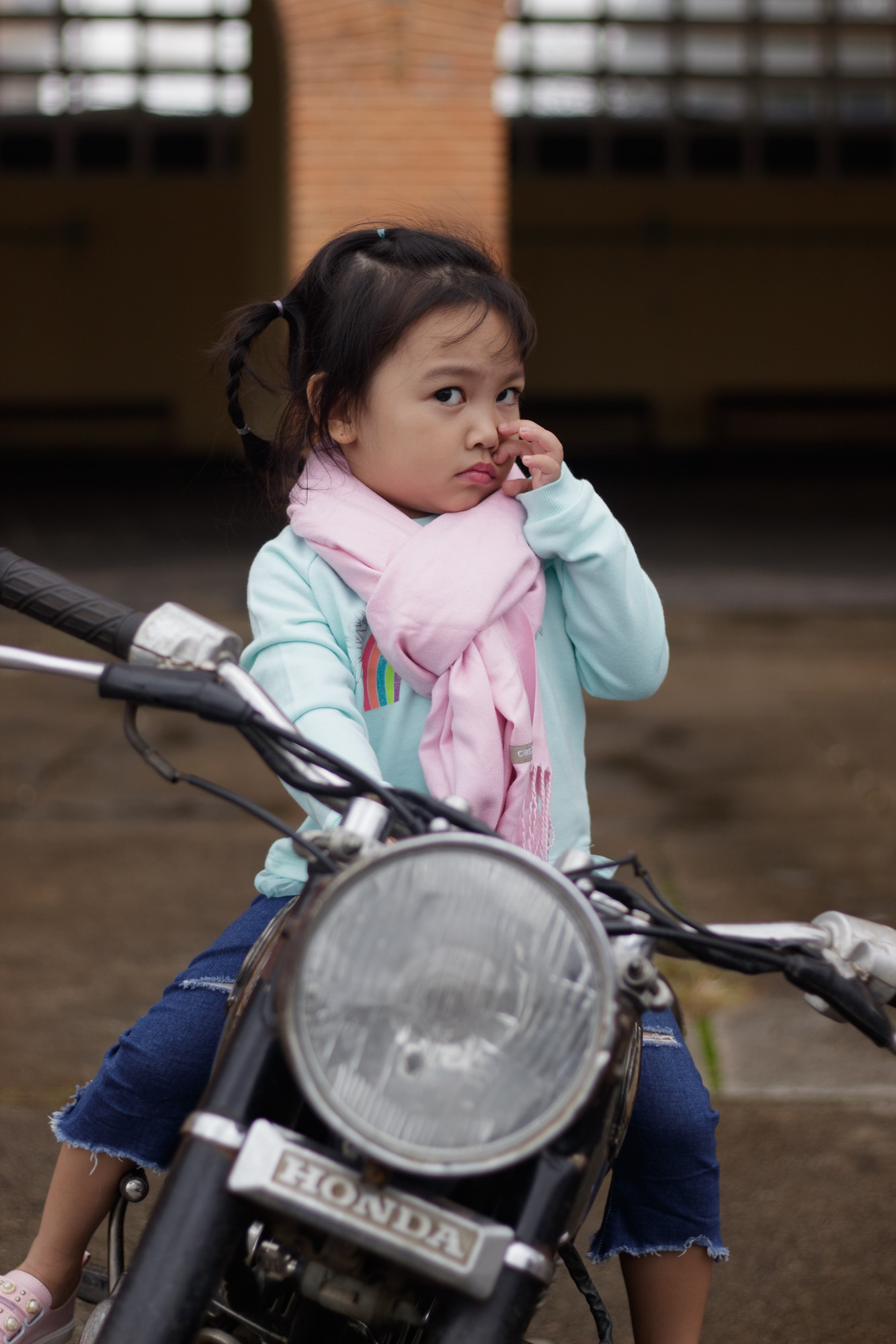 A girl wants to be photographed sitting on a motorbike in Da Lat.