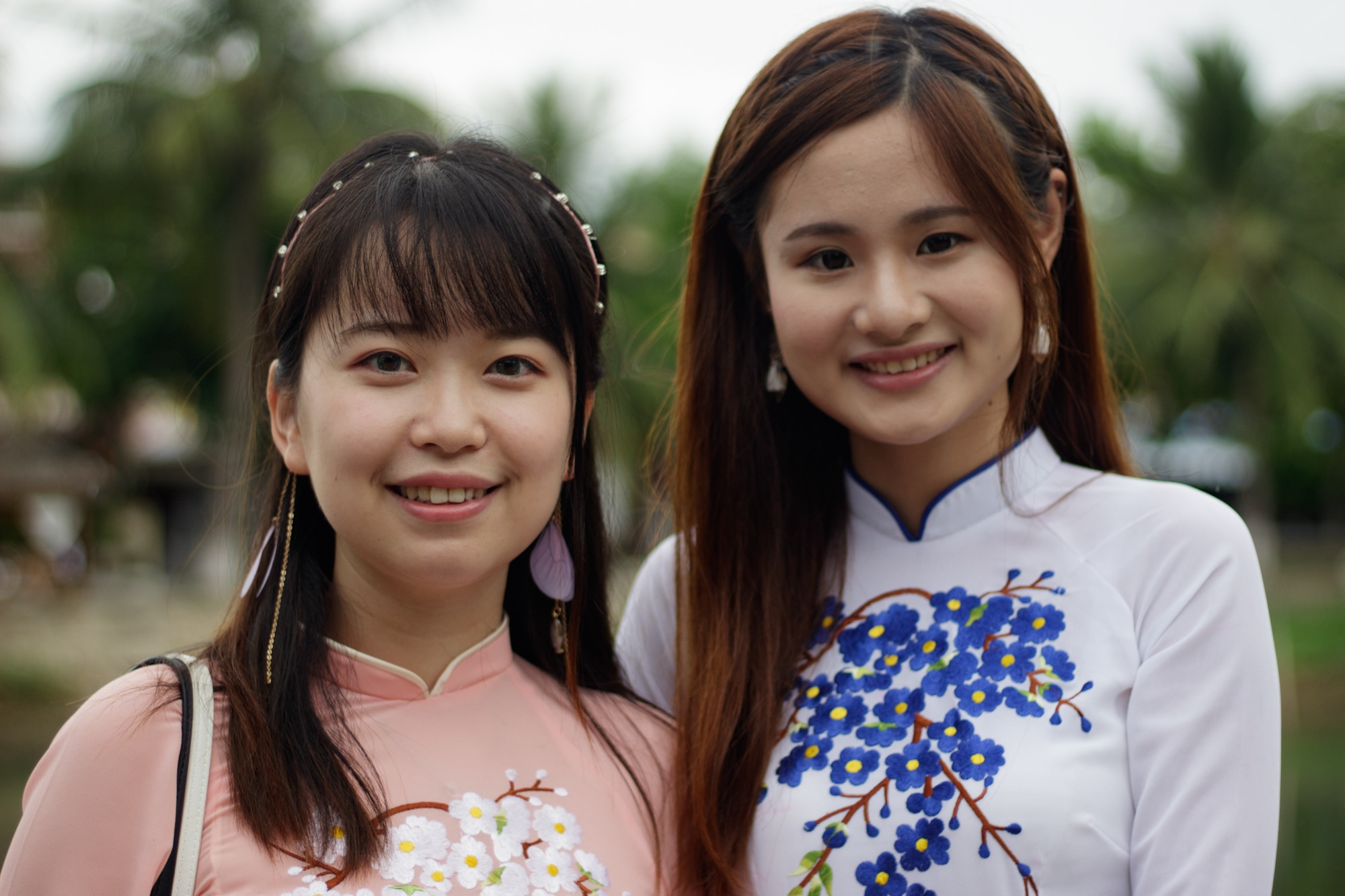 Girls from China dressed in Ao Dai. Hoi An, Vietnam.