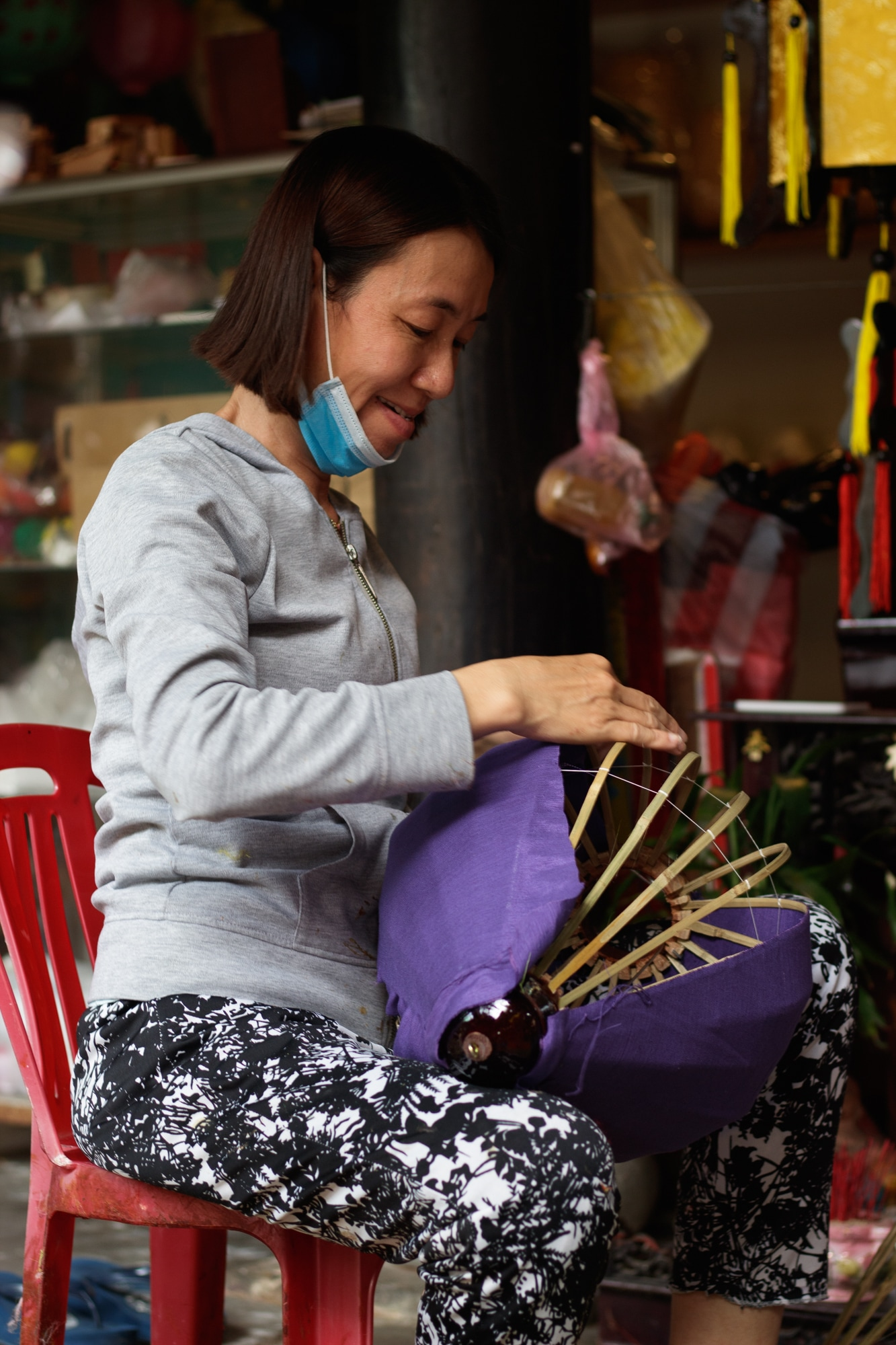 A woman making lamp at a shop in Hoi An.