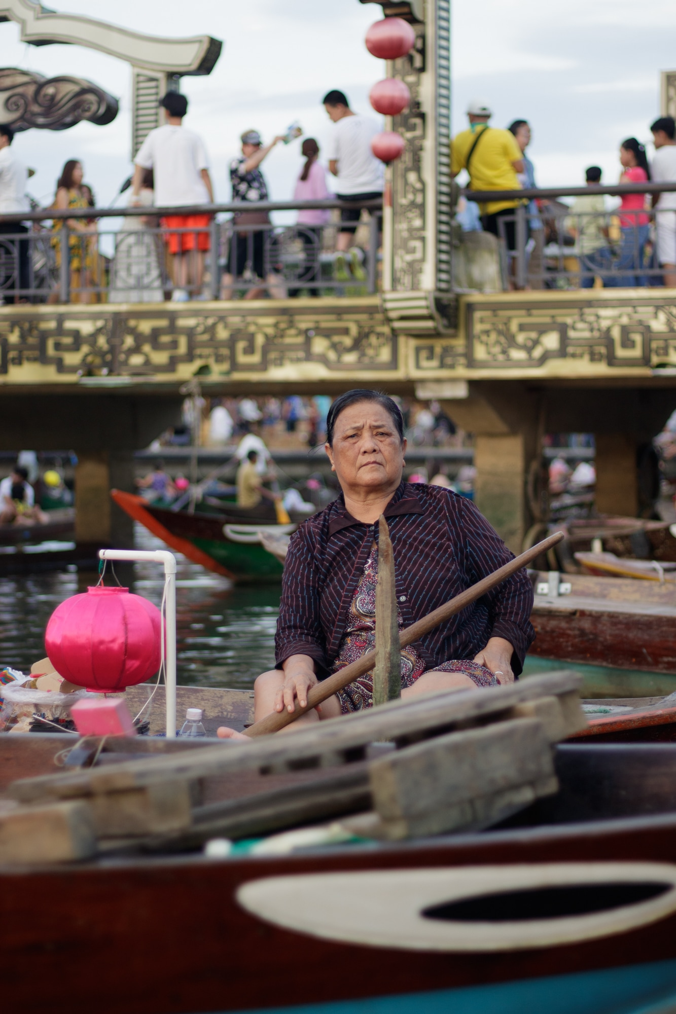 A woman pictured sitting on her boat in Hoi An.