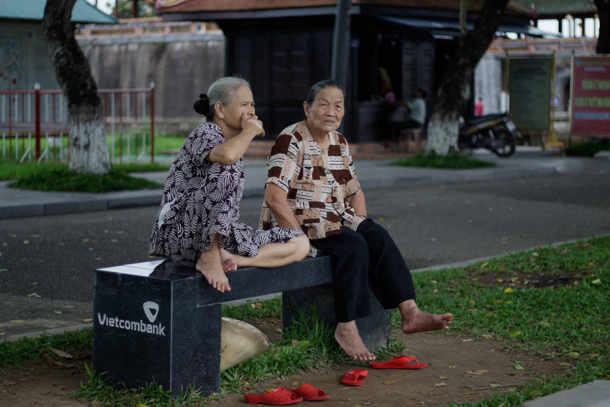 Elderly women photographed in Hue, Vietnam.
