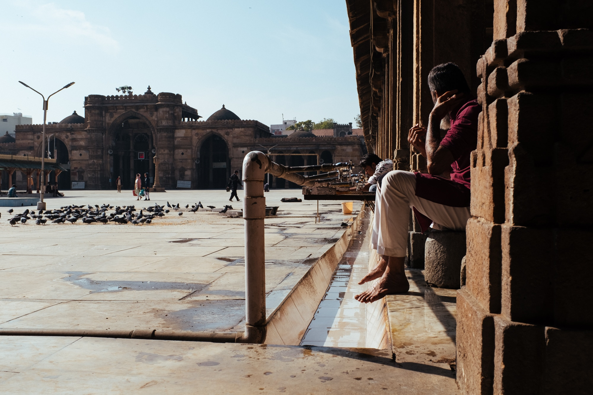 A man performing ablution before prayer at Jama Mosque, Ahmedabad.