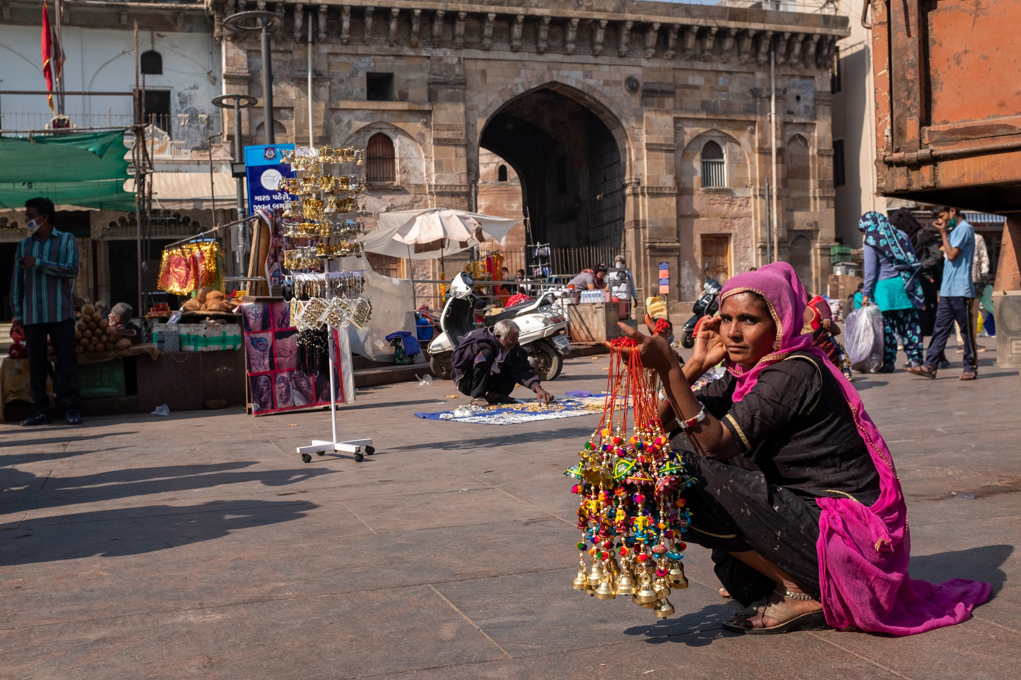 A street vendor selling handmade wind chimes in front of the Bhadra Fort, Ahmedabad.