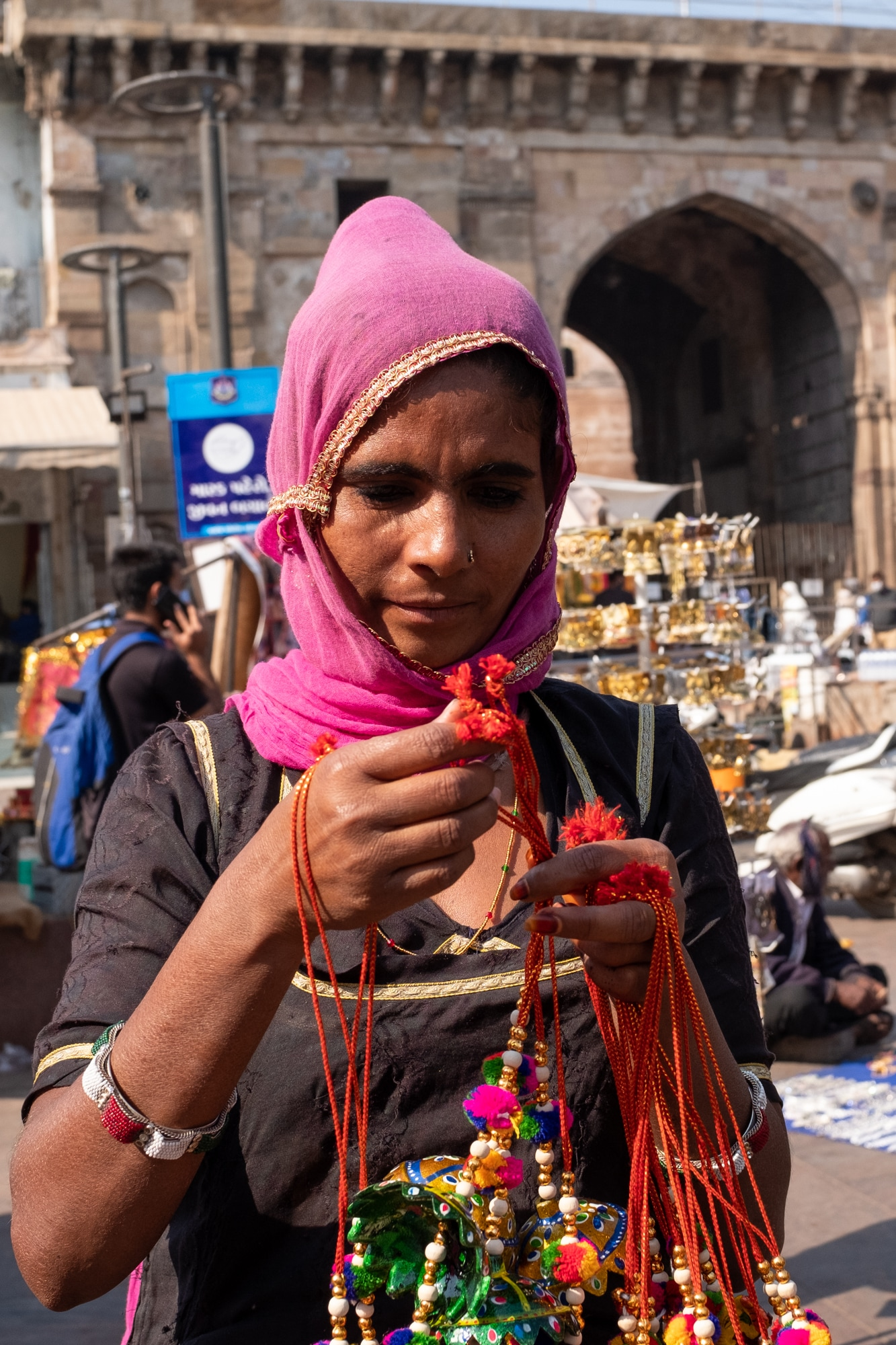 A street vendor showcases handmade wind chimes in front of the Bhadra Fort, Ahmedabad.