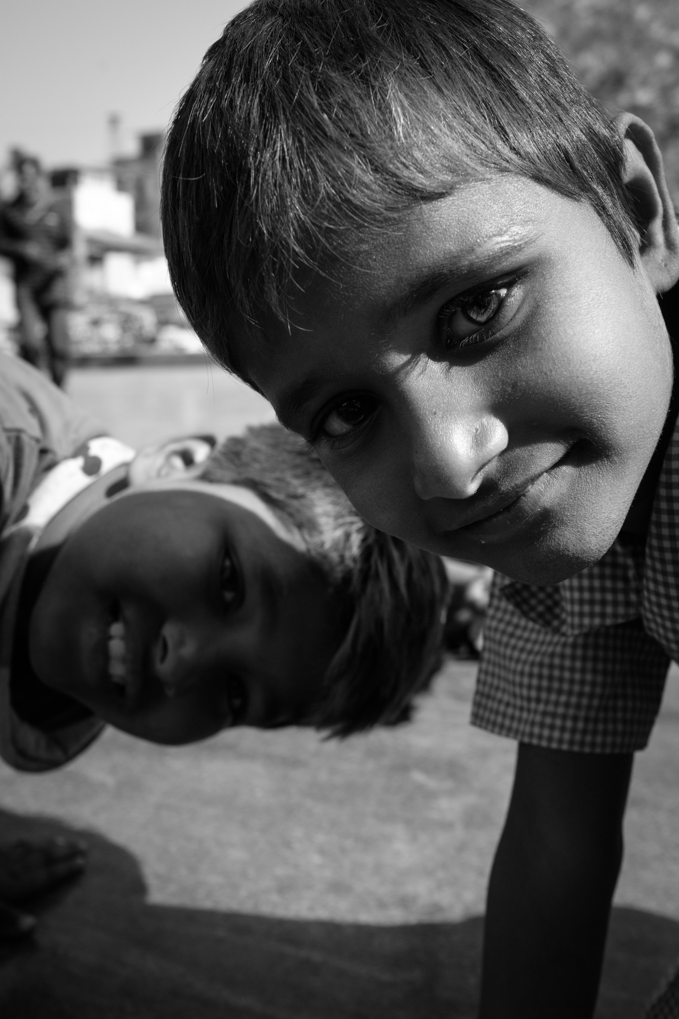 Curious kids look at the camera. Ahmedabad.