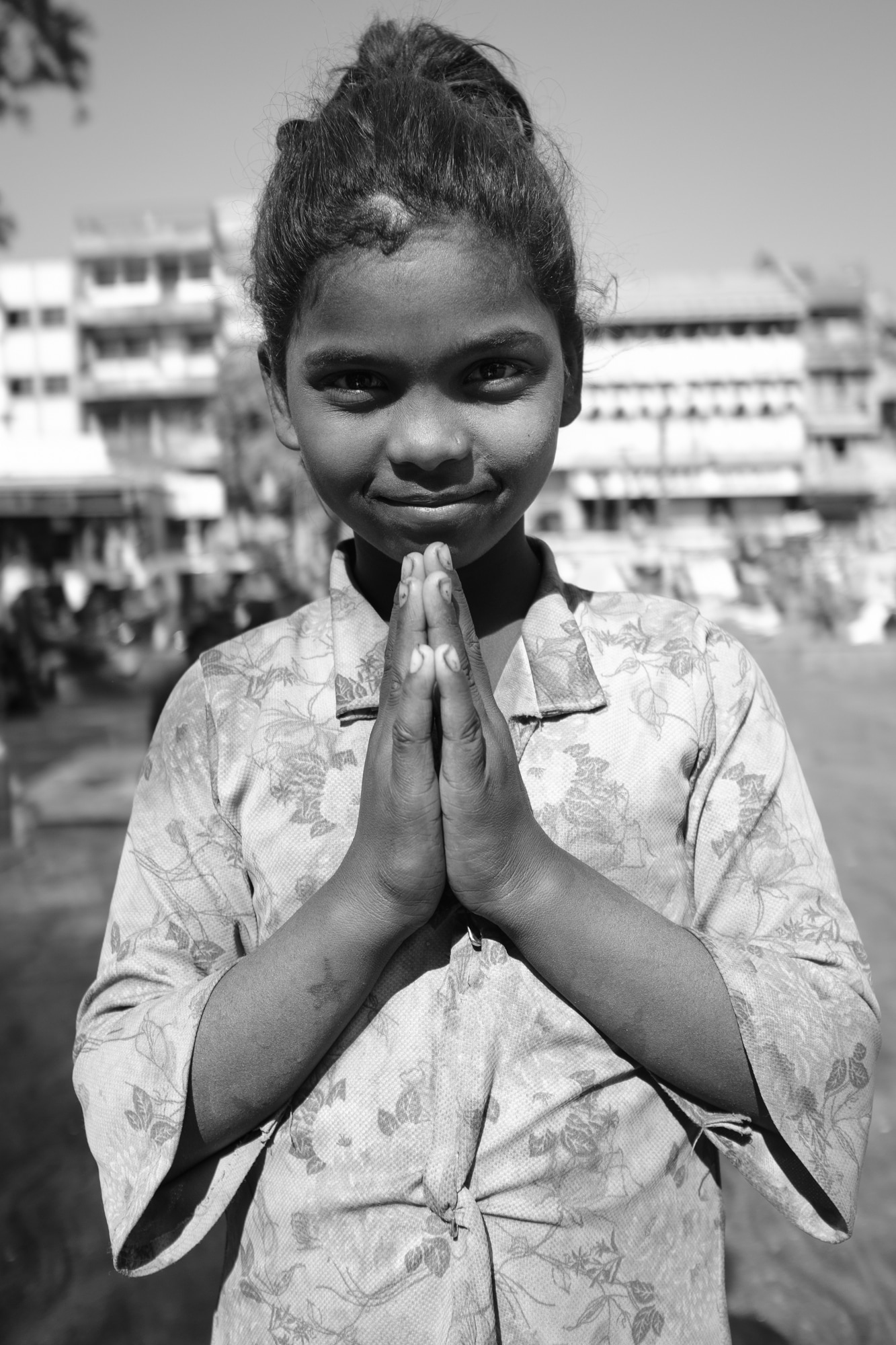 A girl poses with Namaste gesture