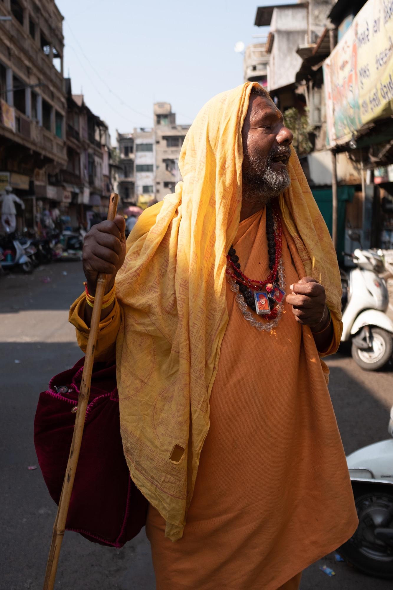 A sadhu seeking alms in street of Ahmedabad