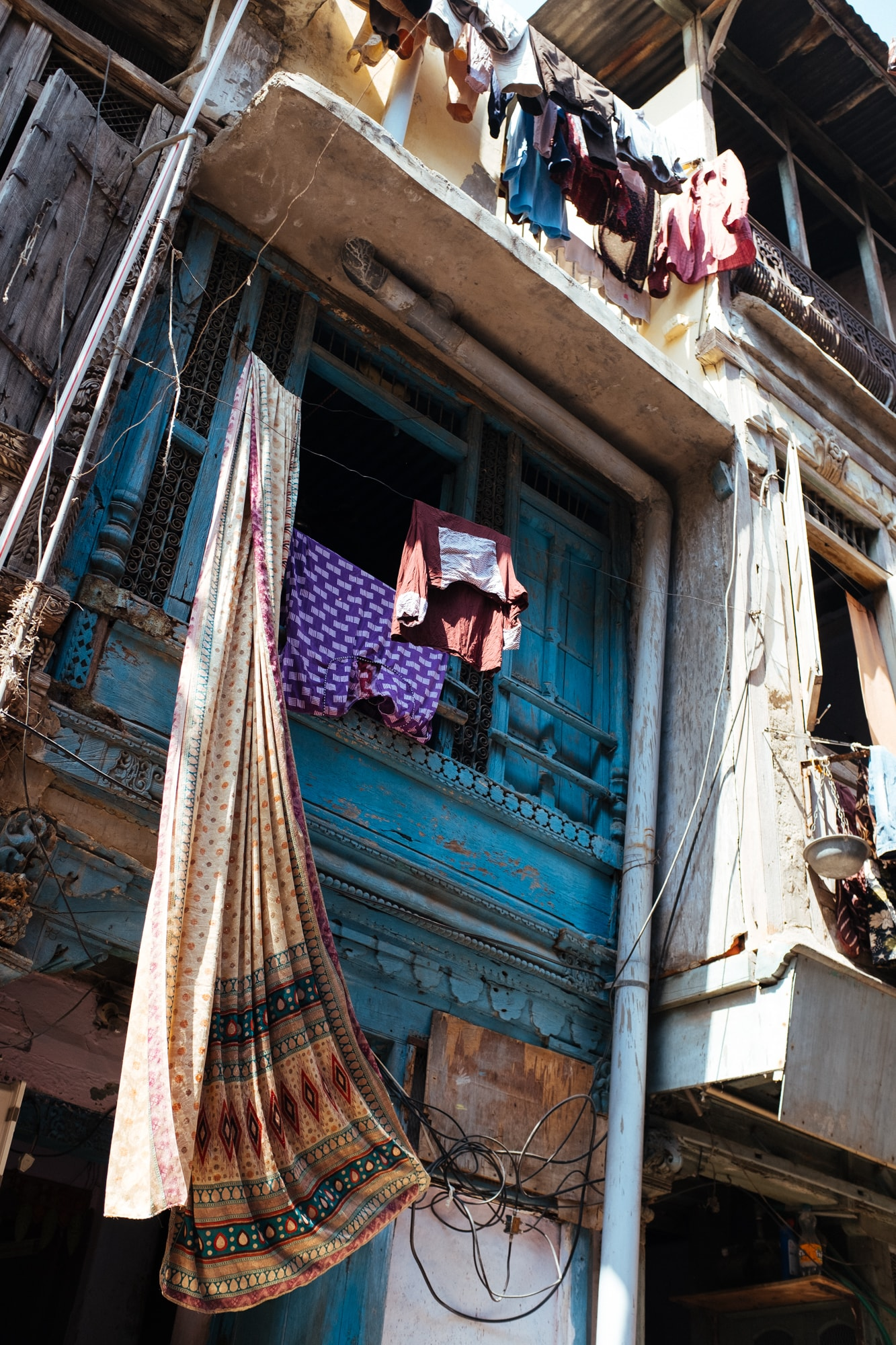 A sari along with other clothes drying outside balcony of a house in Upli Sheri, Ahmedabad