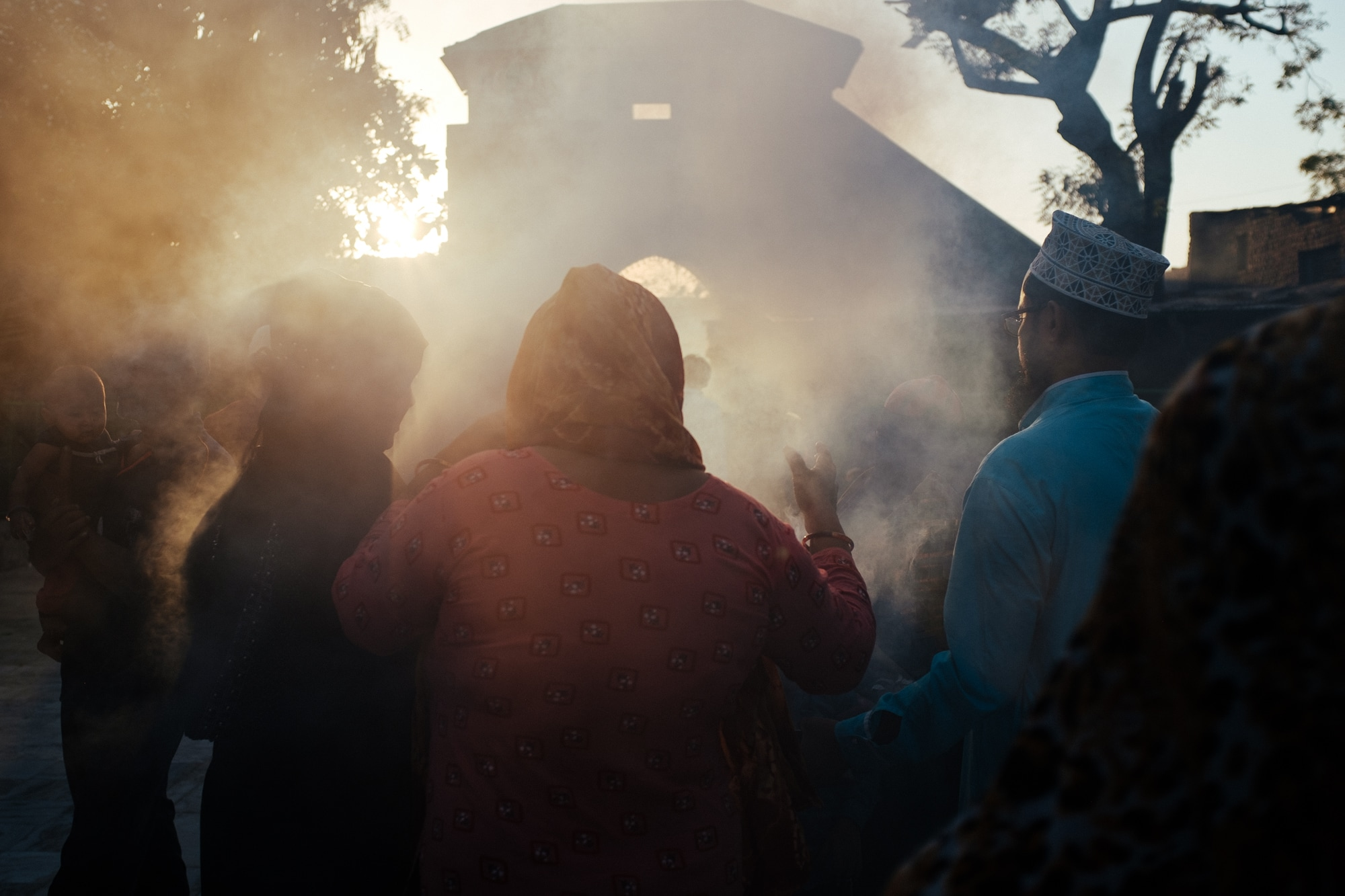 A crowd of devotees during the daily gum benzoin or frankincense burning ritual. Burning gum benzoin is a common daily or ceremonial practice in Indian households, temples, and shrines.