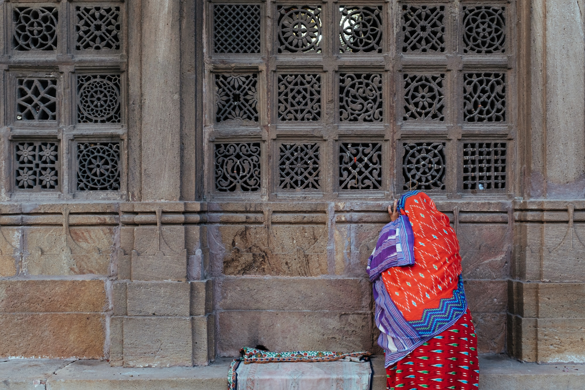 A woman at Shah-e-Alam shrine, Ahmedabad, during a weekly ceremony