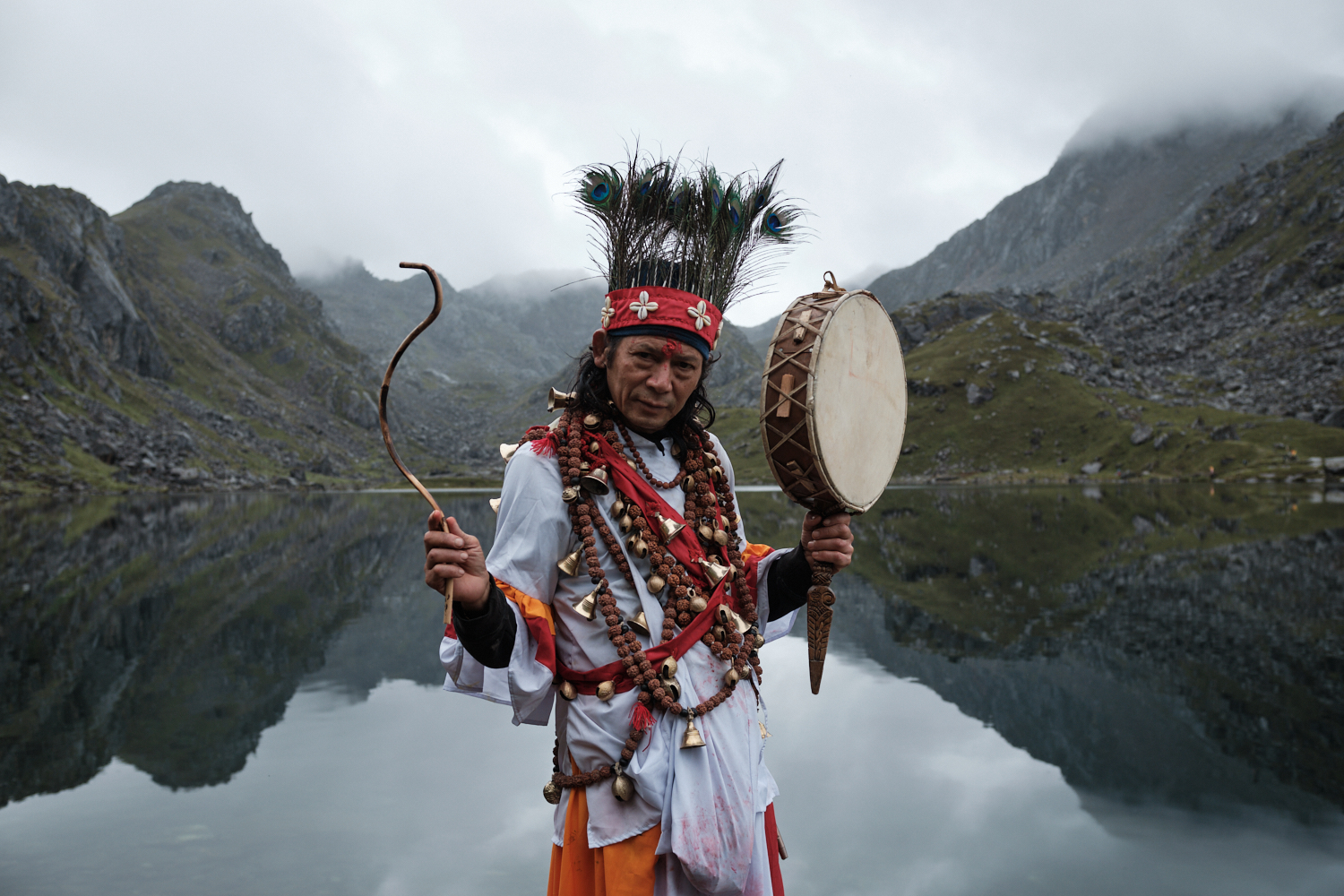 A shaman poses for a picture by the Gosaikunda Lake, Nepal
