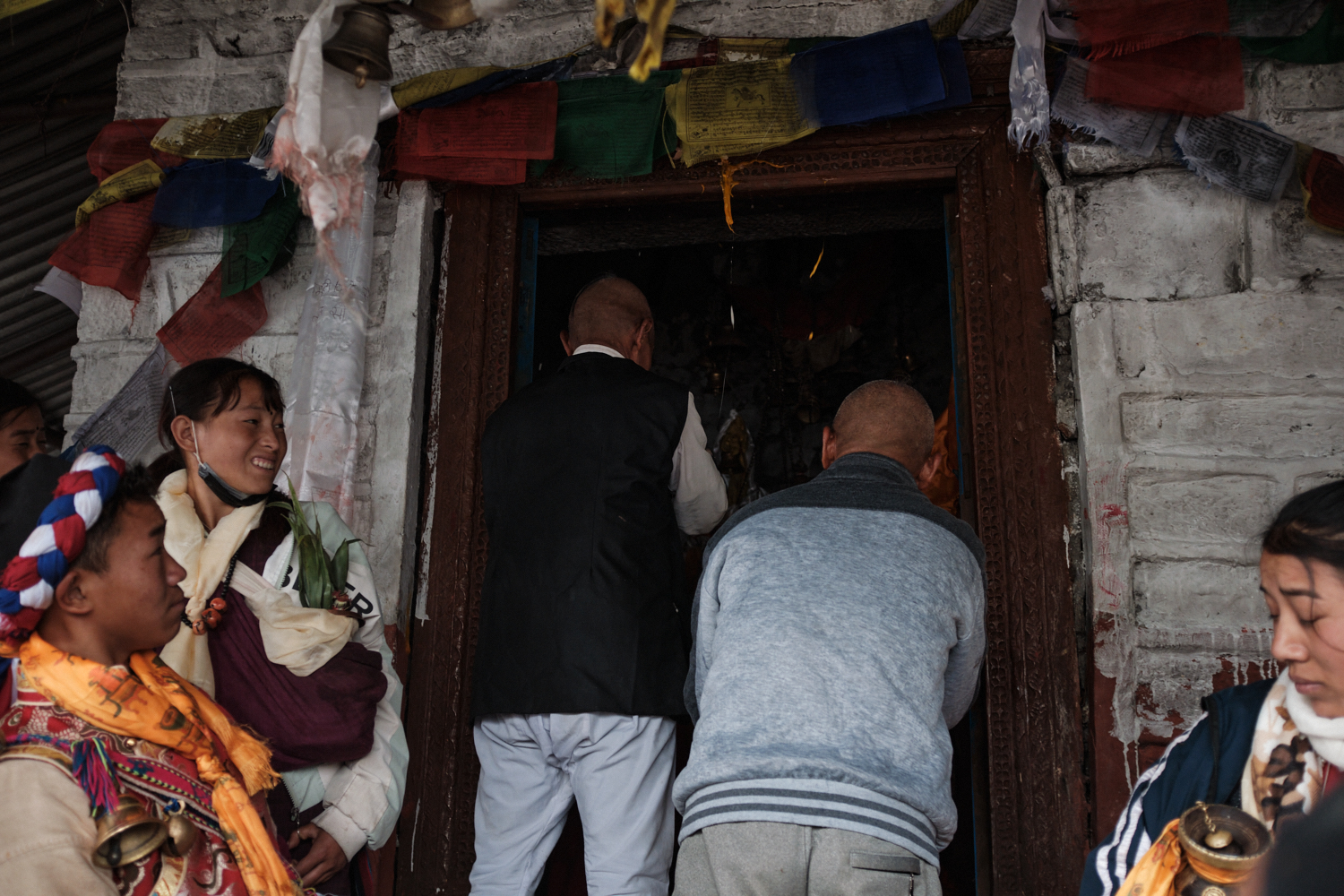 Observers react to an egg being thrown at the temple's door frame after the completion of a competition