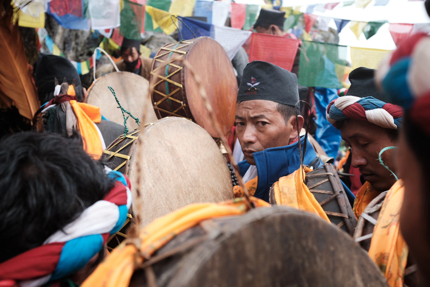 Shamans participate in rituals with traditional dhyangro drums
