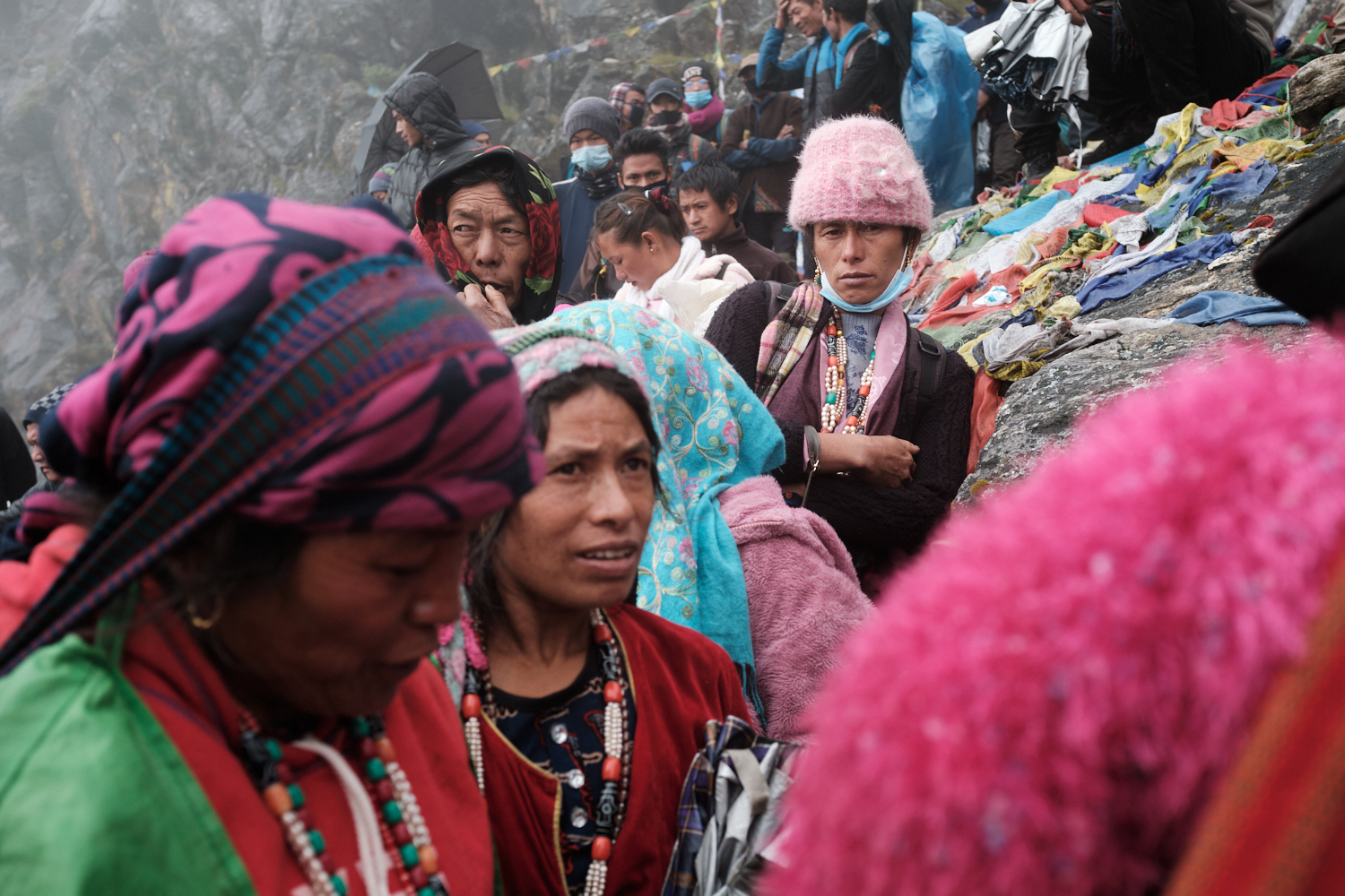 Women observe shamans engaged in rituals at Trishul Dhara